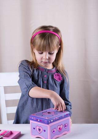 decorates: Little girl decorates the box.