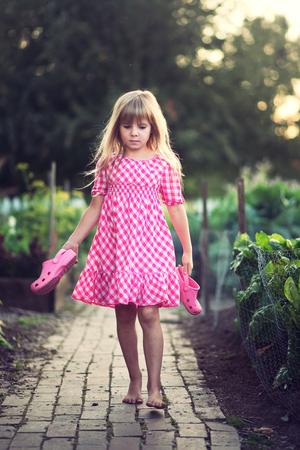 Small girl at the garden