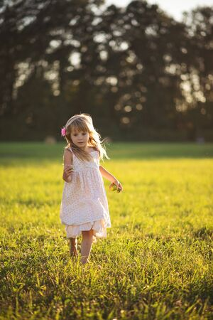 Little girl running in a field.