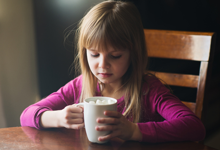 Young girl with hot chocolate Banco de Imagens