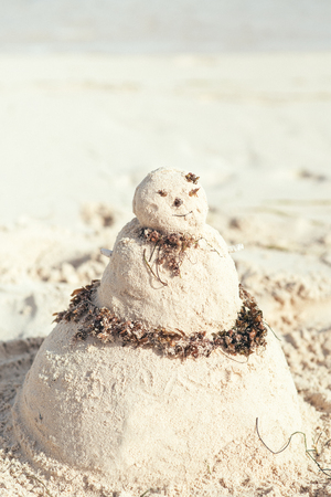 Sand snowman at the beach