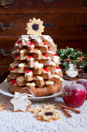 Christmas tree Pandoro (pan doro) is a traditional Italian sweet yeast bread, most popular around Christmas and New Year photo