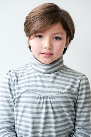 Adorable 8 years old girl portrait for documents