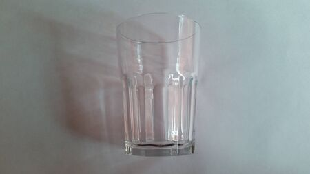 A glass cup. It is empty