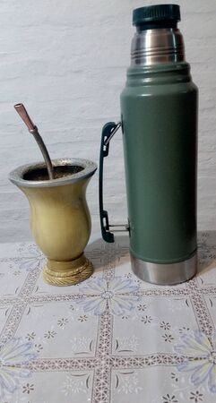 """You can also see a lined pumpkin where the drink called mate with metal rim is made. In this infusion you can see part of the pumpkin (container), yerba mate and a straw called """"bombilla""""."""