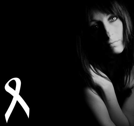 white ribbon for violence against women photo