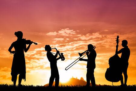 musicians at sunset 写真素材