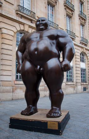 to mongolian statues standing position by Shen Hong Biao in Paris city Editorial