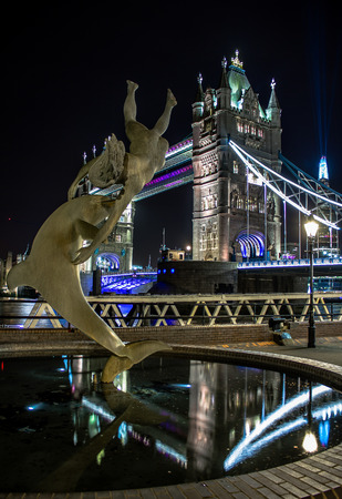 draw bridge: The girl and the dolphin Tower Bridge Editorial
