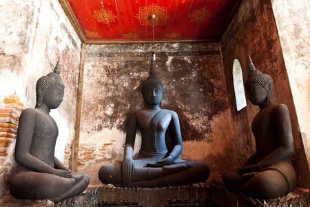 three black buddha against the ancient wall Stock Photo - 8552587