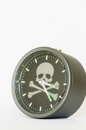 alarm clock with skull and bones on white background  Stock Photo - 24636122