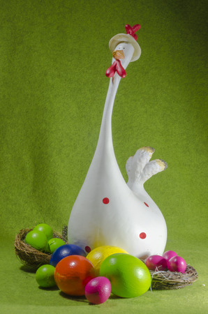 pullet: an enjoyable chick with multicoloured easter eggs, vertical, couleur Stock Photo