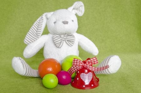christian festival: funny easter bunny an multicolour eggs and bells