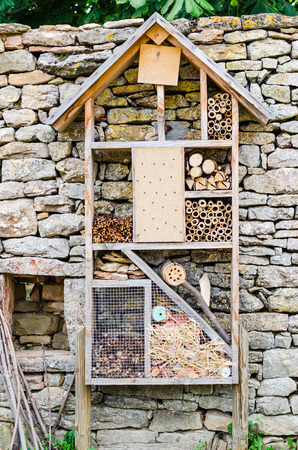 an insect hotel in wood, color, vertical