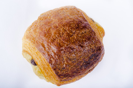 an chocolate croissant, french pastries, chocolate layer cake, color, horyzontal on white background