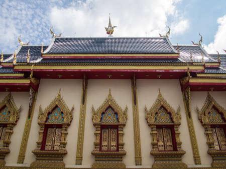 chaimongkol: Chaimongkol temple in Lamphun, Thailand and cloudy sky Stock Photo