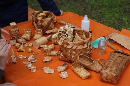log basket: wickerwork and bast, birch bark, baskets and sandals in Russia Stock Photo