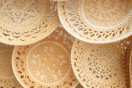 embossing: Plates and sugar bowls made of birch bark, Russian folk art, paintings on birch bark is applied in two ways: embossing or oil paints. Stock Photo