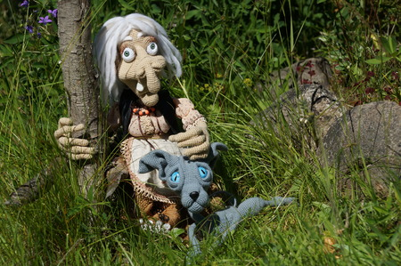 Baba yaga and her faithful grey cat, linked from threads using the hook. On a walk around the wicker fence from twigs.1