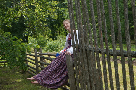 european white birch: Russian girl in a sundress sitting on a wooden fence resting1 Stock Photo