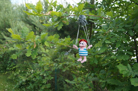 raised viewpoint: toy paratrooper parachute hung on a tree 1