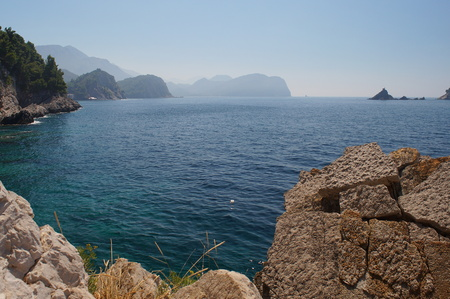 ecologically: the ecologically cleanest Adriatic sea, rocky beach on the Montenegrin coast,horizon blue sky Stock Photo