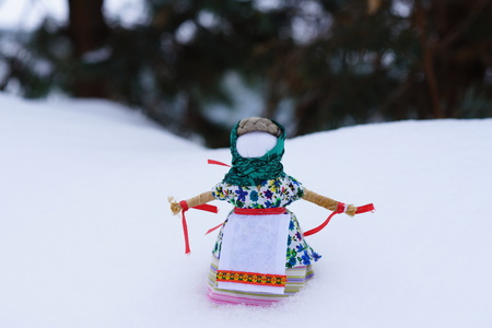 carnival doll for the burning festivities in the winter Maslenitsa in the snow