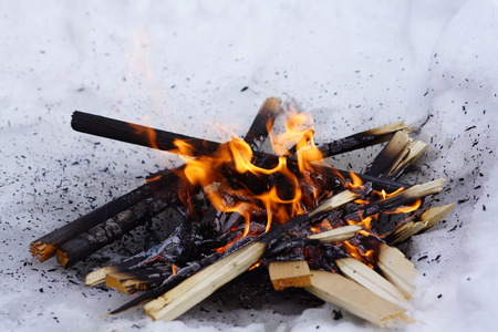 Burning doll Maslenitsa celebration in the Russian Orthodox rite in the snow