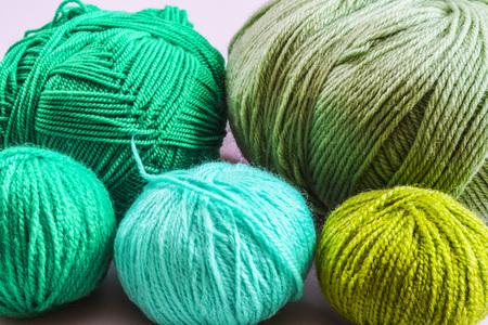 knitting wool balls green. Yarn as the background.