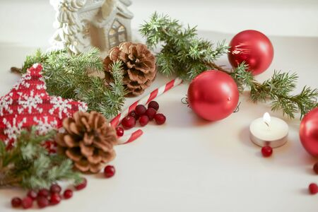 2018 christmas card with green christmas tree and a burning candle stock photo 91264668