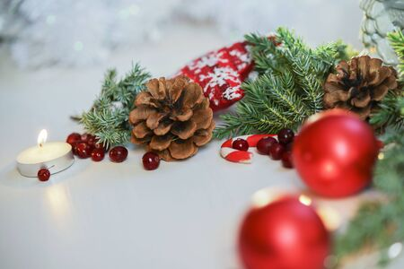 Christmas decoration for table,Christmas tree red balls, burning candle with fir branch and candle on wooden background