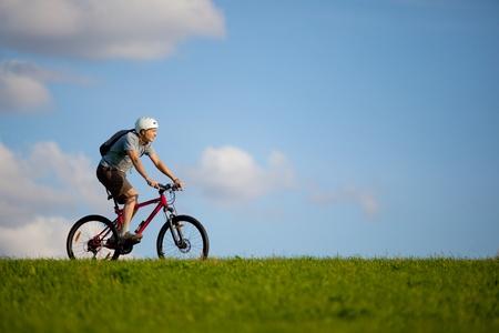 Men on mountain bike.