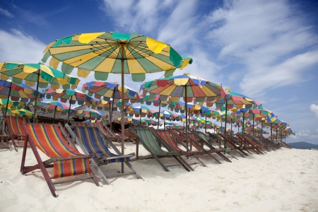 Colourful Deck Chairs On a Vacation Beach  Stock Photo