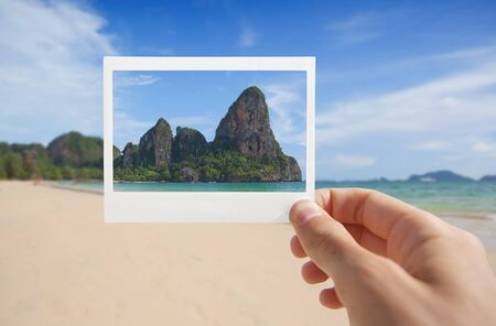 Hand With Photo of Beach  Standard-Bild