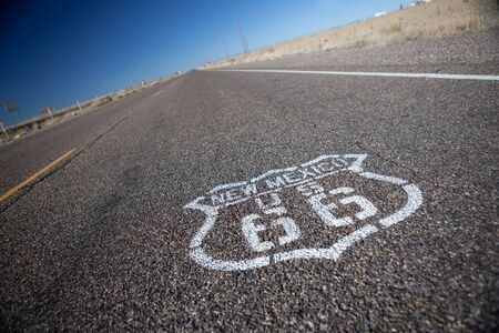 Route 66 printed on pavement, selective focus. Stock Photo