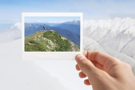 polaroid frame: Holding Instant photo on a winter background.