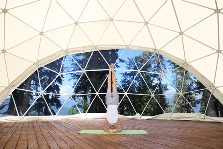 mat like: Headstand in beautiful yoga place.