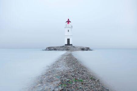 Tokarevsky lighthouse at the misty day. Vladivistok, Russia. Standard-Bild