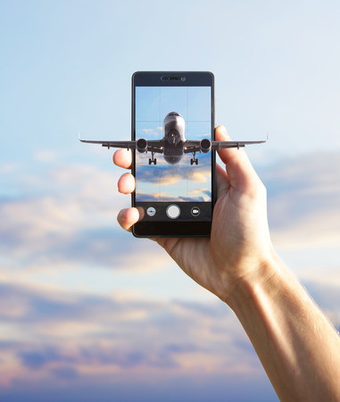 Airplane flying out the smartphone. Stock Photo