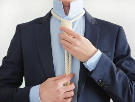 Hangmans noose  around businessman neck. Stock Photo
