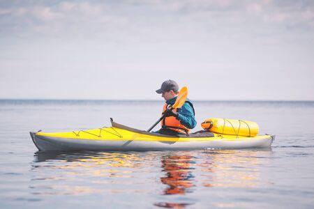 Kayaker paddling on the sea.