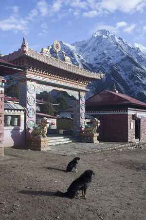 Entrance Gate in Tengboche Monastery with Himalayas Mountains on Background. Nepal. Trek to Everest Base Camp.