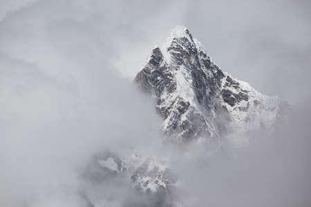 Tobuche Peak, in Stormy Clouds, Nepal. Trek to Everest Base Camp.