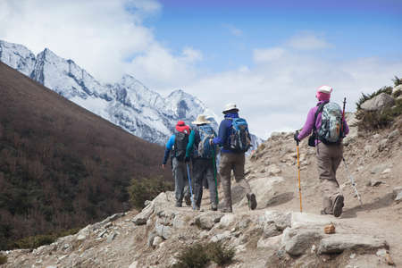Nepal, Khumbu Region - 27 April 2011. Group of Travelers Hiking on Trail to Everest Base Camp. Nepal, Himalaya Mountains.
