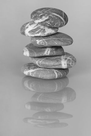 cairn: The cairn of balanced stones with reflection