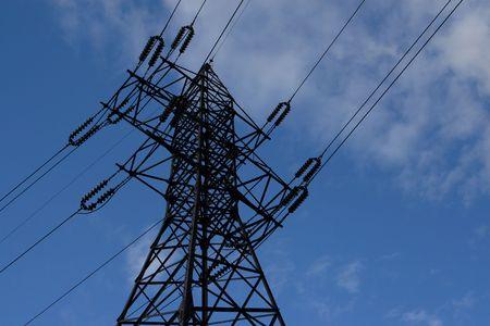 isolator insulator: High voltage iron line on blue sky