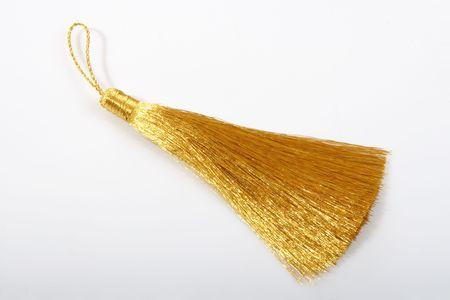 Golden tassel on white background for tailor