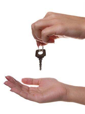 handing: Handing over the keys on white background Stock Photo