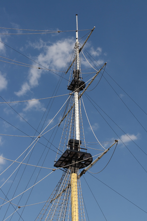 Mast of ship on blue sky and clouds background Stock Photo