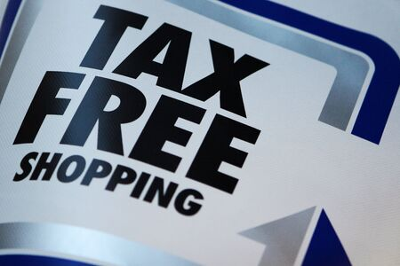 Tax free shopping. Flag on street shop.